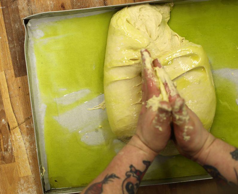 Making focaccia dough in Italy in Bonvicino, Piemonte, Italy