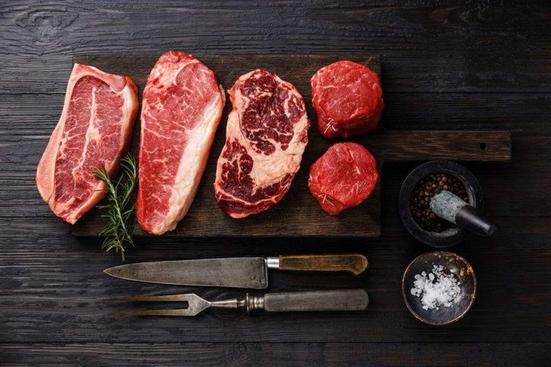 raw steak cuts with marbling