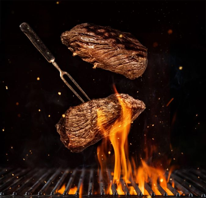 Flipping steak with grill marks