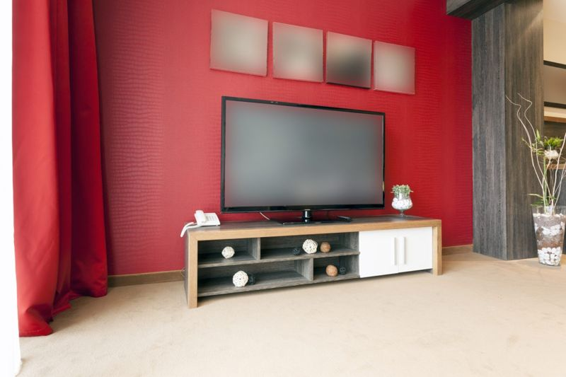 https://www.gettyimages.com/detail/photo/big-tv-in-modern-apartment-royalty-free-image/502274705?adppopup=true