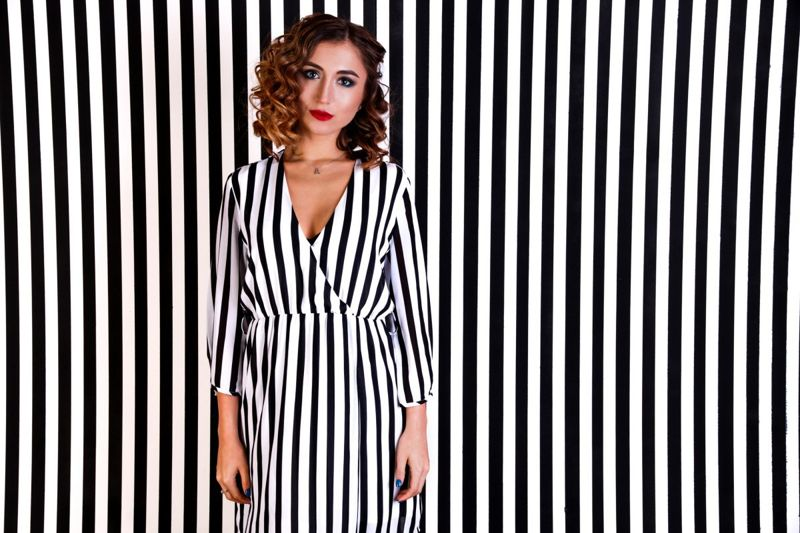 Woman in vertical striped dress