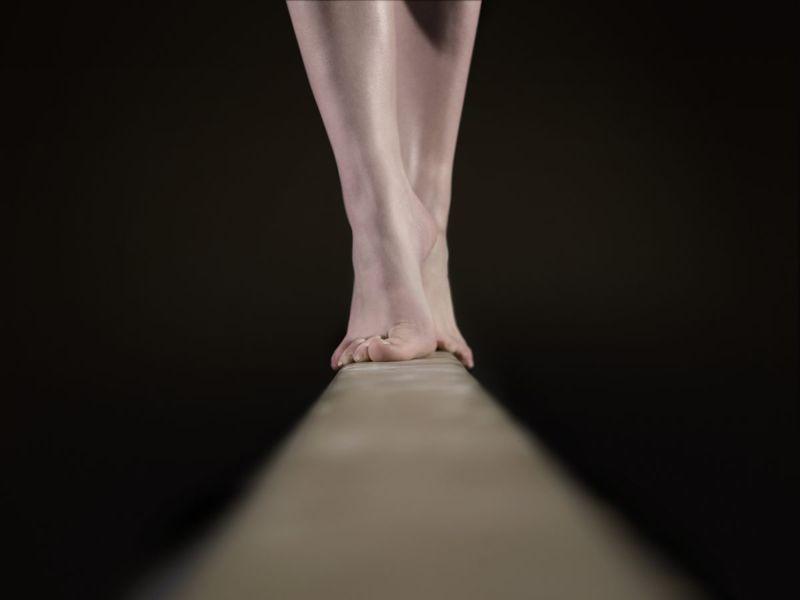bare feet on balance beam