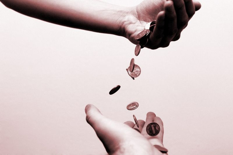 pennies dropping from one hand to another