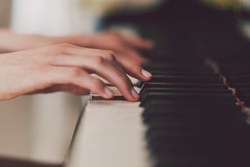 woman fingers playing piano
