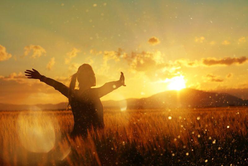 woman in field positive energy