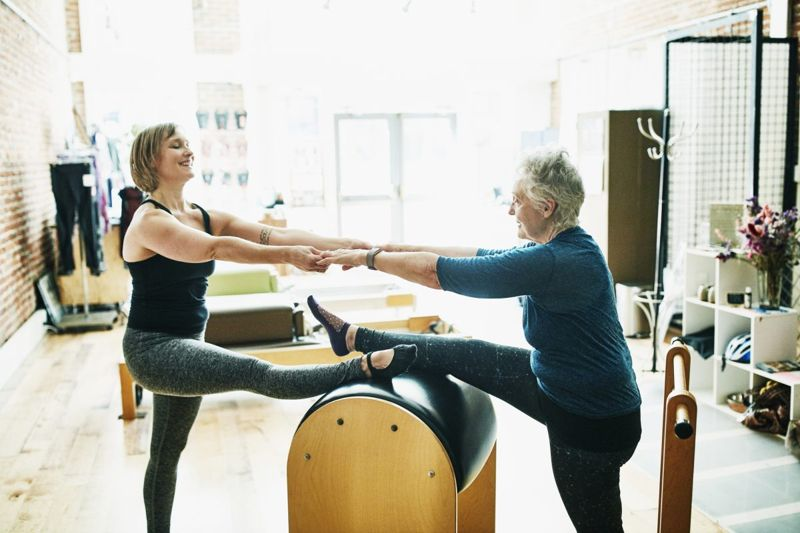 Mother and daughter doing pilates