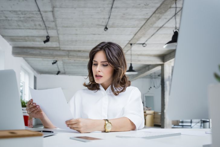 Worried businesswoman reading a document