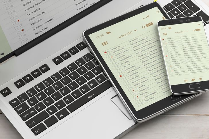 Email lists on smartphone and tablet screens, computer keyboard and office desk, banner. 3d illustration