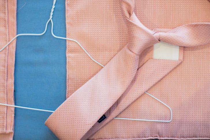 Pink tie half Windsor knot with hanger.