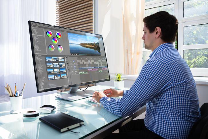 Editor editing video on computer