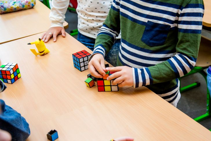Rubik's cube in the hands of a child