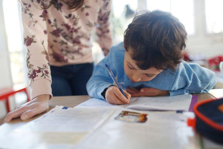 A boy doing his homeworks