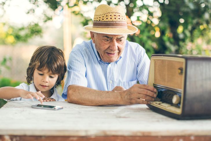 Portrait of a small boy with his grandfather