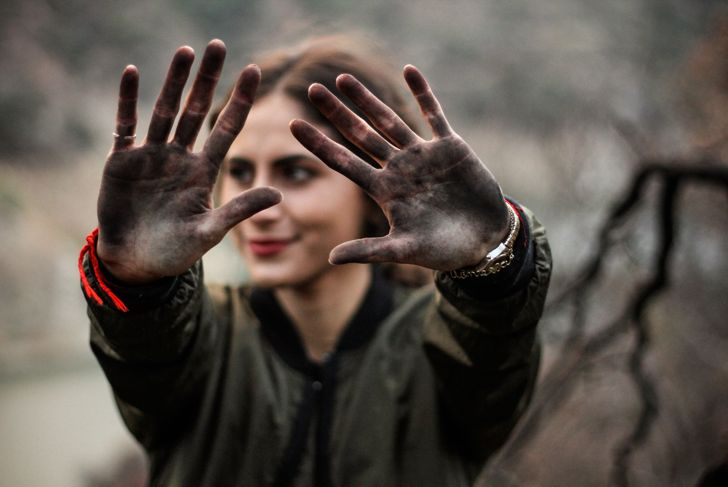 woman showing her dirty hands after rough work