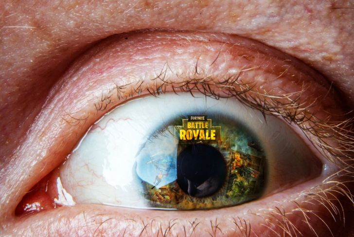 Fortnite game logo reflection on eye.