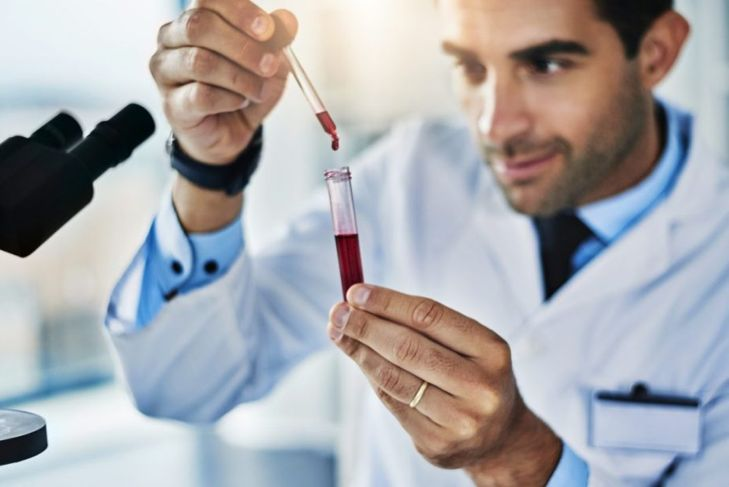 scientist testing blood