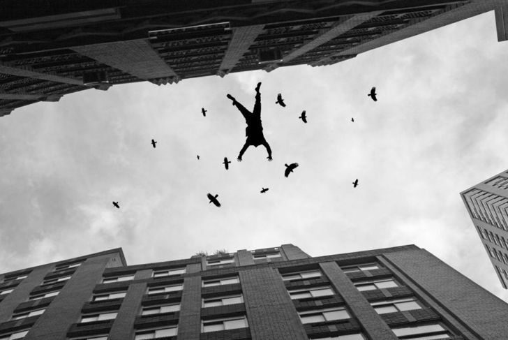 man falling off roof