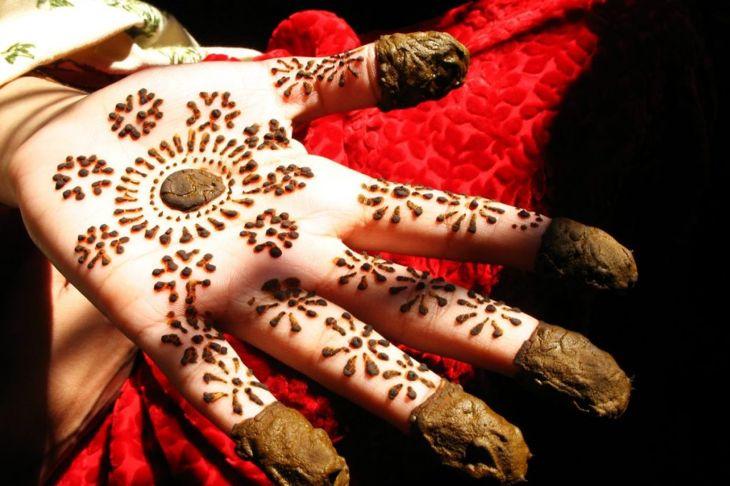 henna tattooed hands