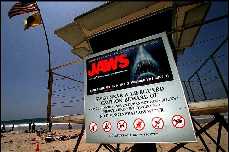 """A poster advertising the anniversary collector's edition of the movie """"Jaws"""" is posted on a lifeguard tower June 2, 2000 on Zuma Beach in Malibu, CA. The sign has led to complaints by beach goers with young children, who feel that it is inappropriate for the sign to be on display so close to the water and so near the 4th of July."""