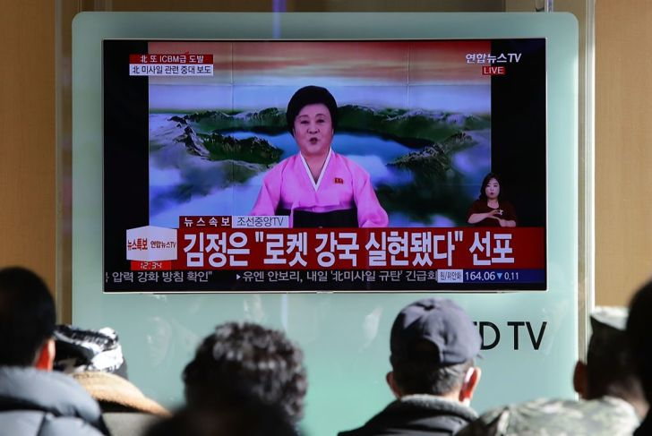 People watch a North Korea's KRT television show, as a presenter announces North Korea has test-launched its country's new ICBM, at the Seoul Railway Station on November 29, 2017 in Seoul, South Korea. Despite of US President Trump's warnings, North Korea fired an intercontinental ballistic missile early today for the first time in four months. The Pentagon has said that the missile had flown for about 1,000km (620 miles) before falling into the Sea of Japan. (