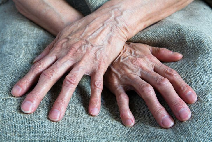 Working wrinkled hands of an old woman