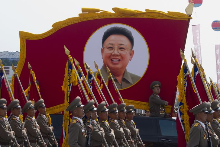 North Korean soldiers at the military parade in Pyongyang with the portrait of Kim Jonhg-Il