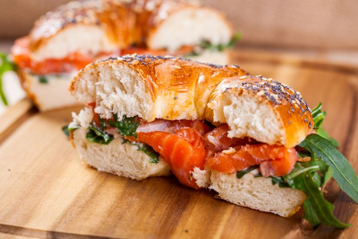 Bagel with salmon and arugula