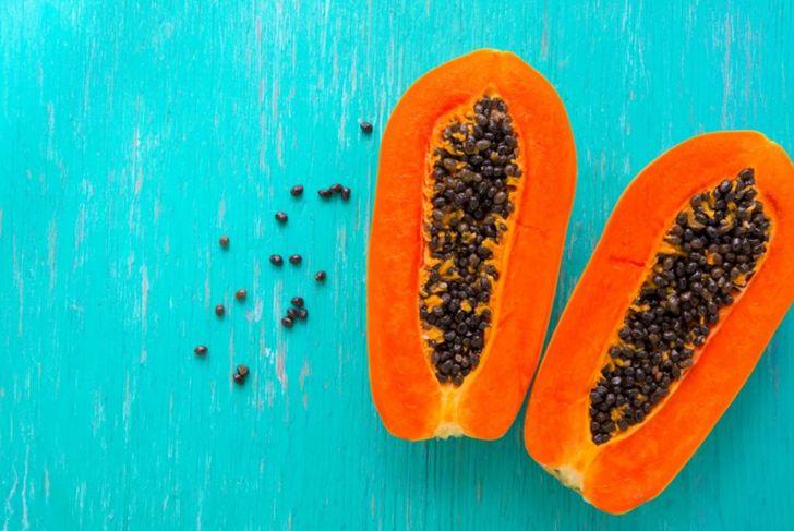 Papaya fruit on wooden background