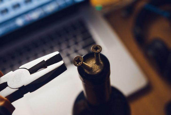 hammer screwdriver pliers wine bottle