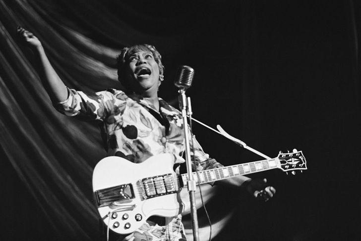 American gospel singer Sister Rosetta Tharpe (1915 - 1973) performs at a Blues and Gospel Caravan tour in the UK, 1964.