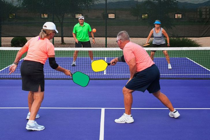 Two teams playing Pickleball