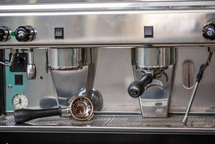 barista cleaning steam brewing filter