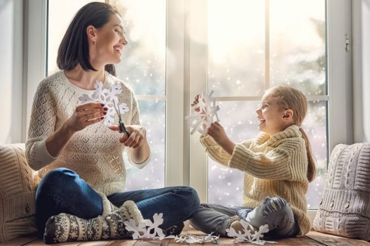 family craft snowflake sharing
