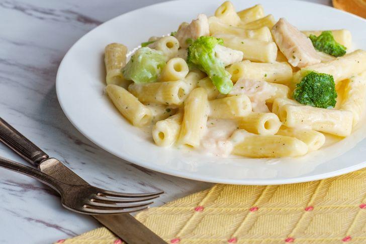 Italian rigatoni chicken alfredo pasta dish with broccoli