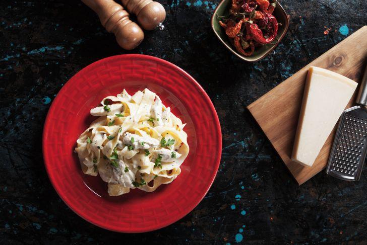 Italian chicken alfredo fettuccine pasta in cream and cheese sauce