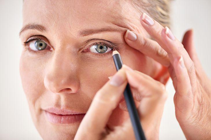 shot of a mature woman applying eyeliner