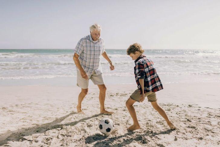 grandfather young boy beach ball
