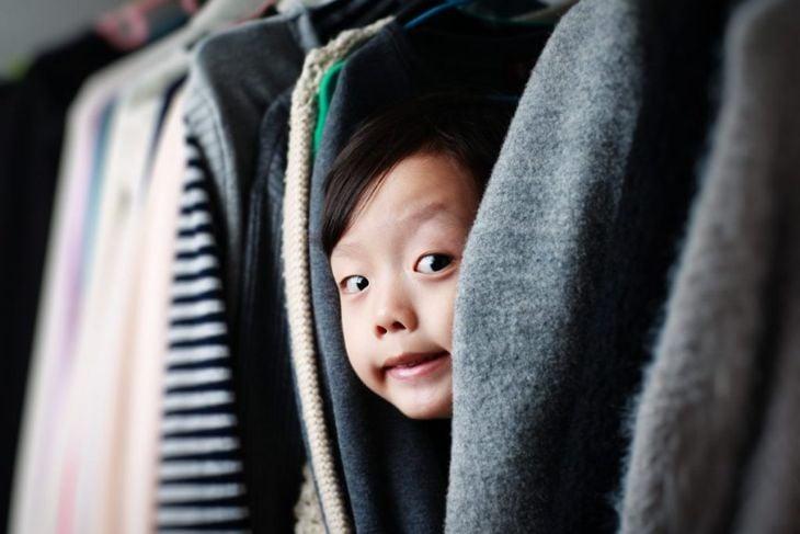 child hiding in closet