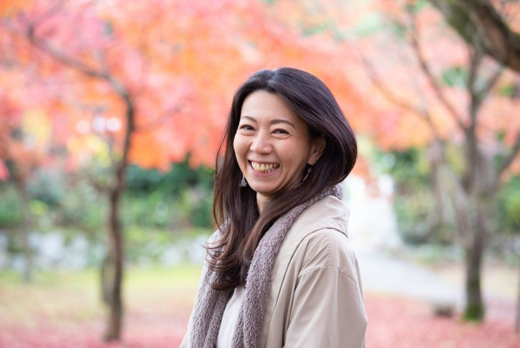 Beautiful Japanese woman enjoying autumn