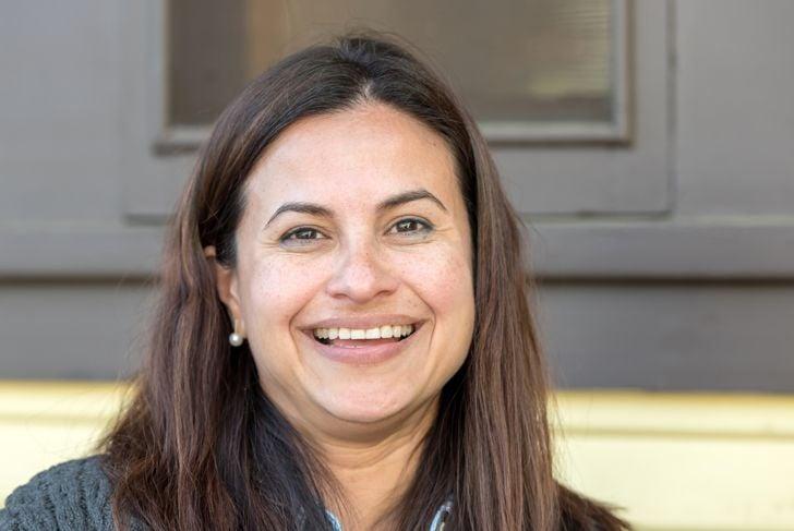 Smiling Mature Hispanic Woman headshot