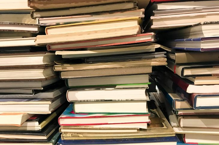 book pile clutter mess