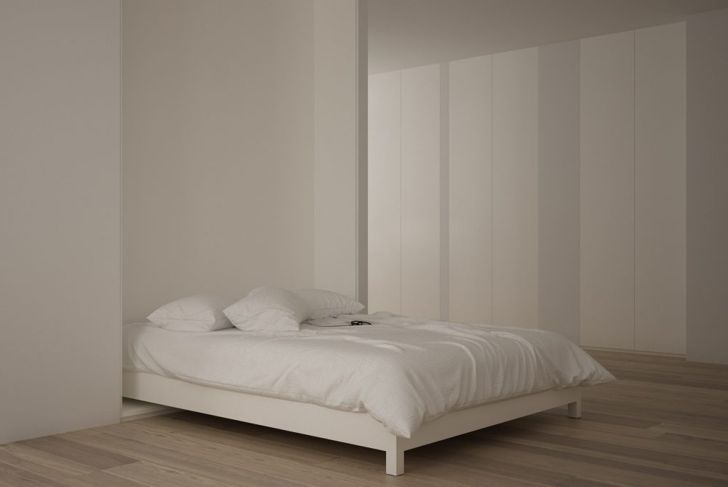A minimalistic Murphy bed that blends into the wall