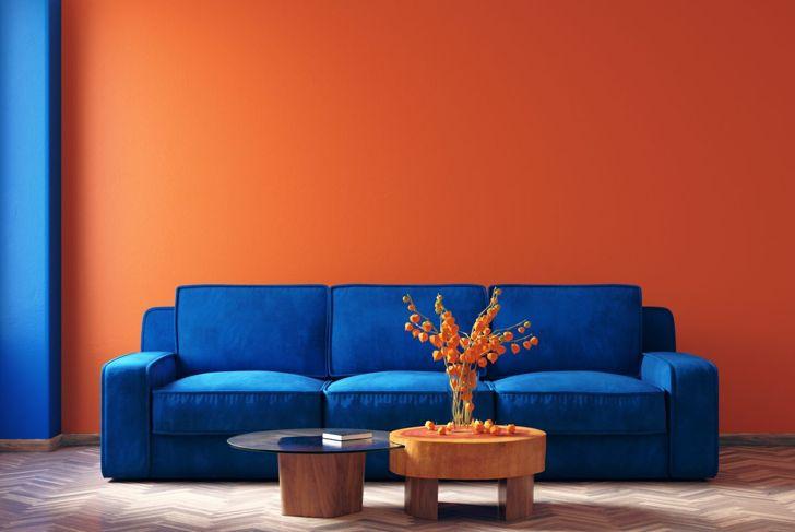 Classic Blue furniture pops against an orange wall.