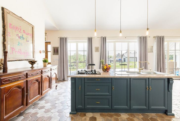 Create a second kitchen with an island outfitted with a stovetop and sink.