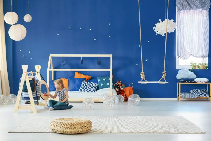 A Classic Blue wall brings peace and calm to this child's bedroom.