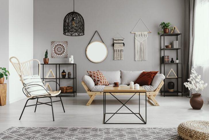 A black macramé hanging lamp in a modern living room