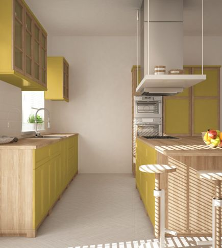 Yellow accents help this small kitchen make the most of its space.