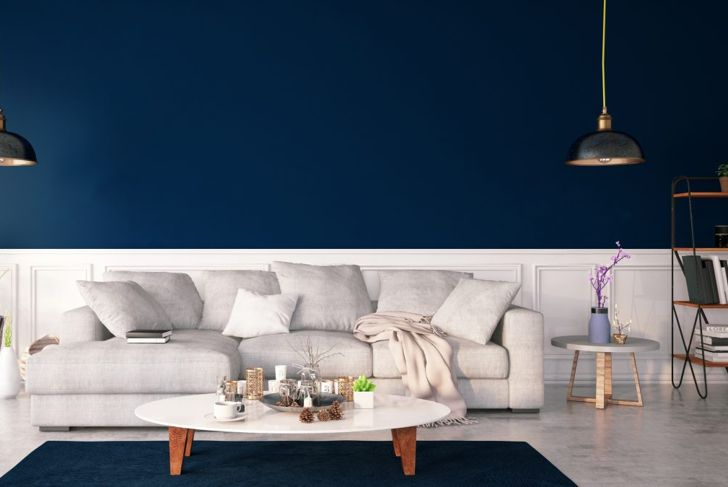 Navy living room with white sofa