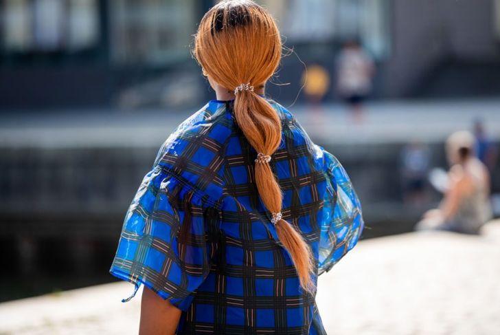 Woman with orange hair wearing multiple scrunchies