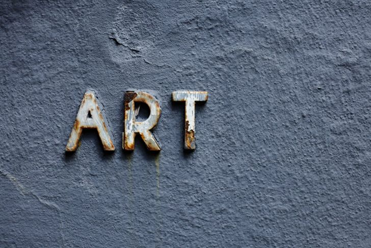 Art spelled out in metal letters on a gray wall